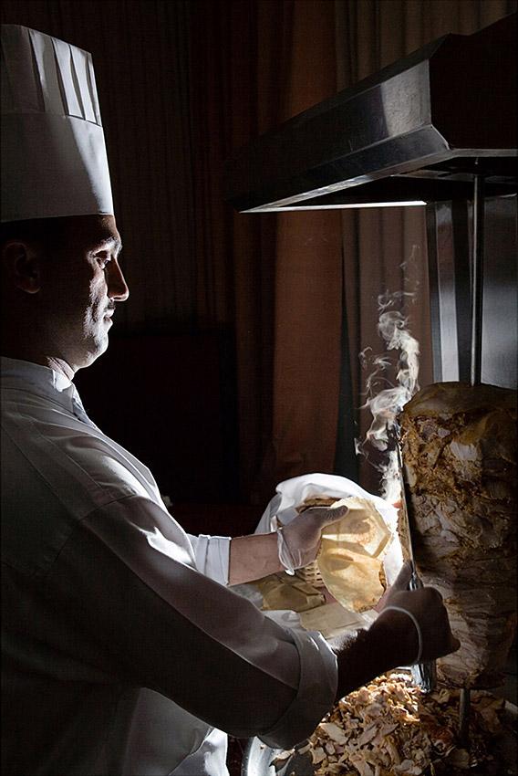 Chef carving a schwarma / souvlaki / kebab