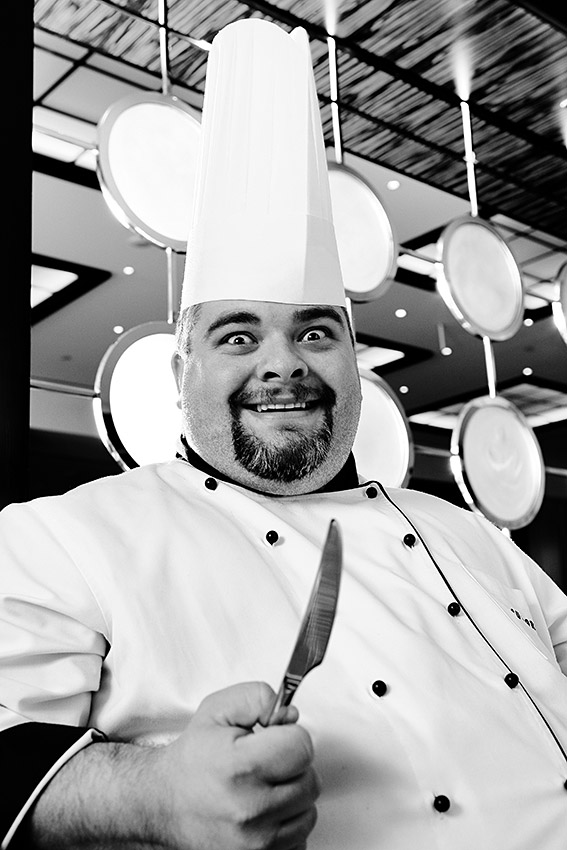 """alt=""""Funny Chef portrait with a knife"""""""