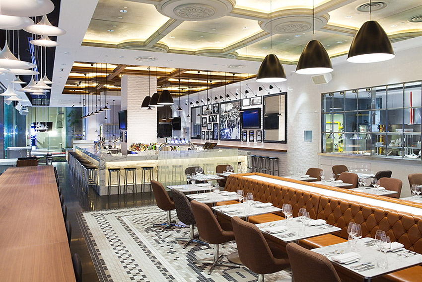 Expansive restaurant & bar interior with mosaic floor, leather seats and ceiling features