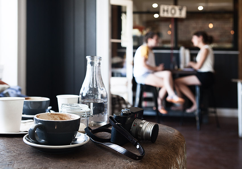 Customers in a Gold Coast cafe with coffee on a table