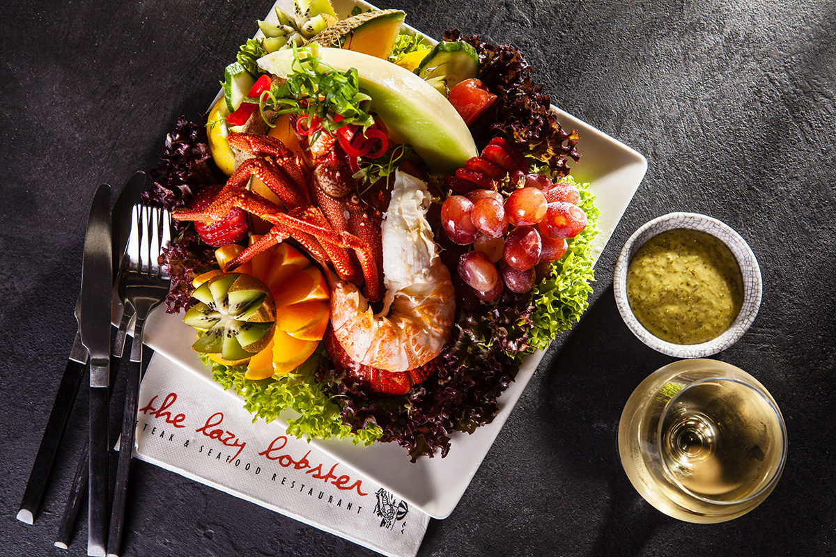 An image of seafood platter served on a contemporary black stone restaurant table