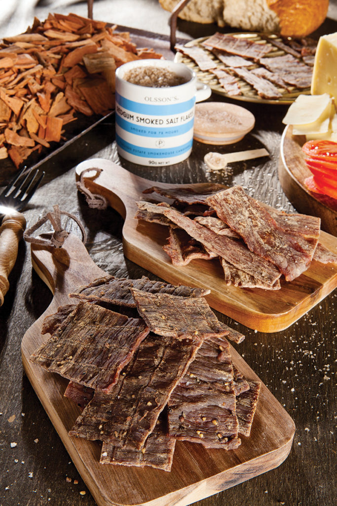 A table filled with seasoned jerky to share
